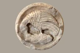 Patera che rappresenta l'eterna lotta tra il bene e il male; Museo Archeologico della Laguna di Marano, museo della laguna